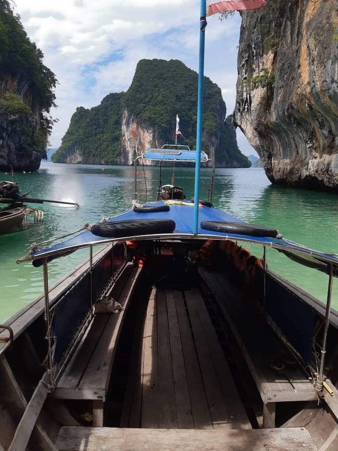 thai longtail boat in an island bay