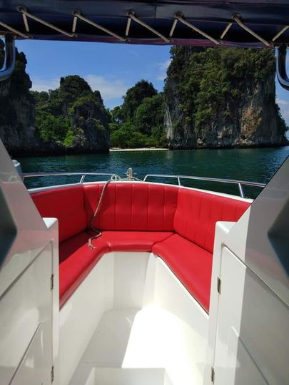 view of an island from a speedboat bow