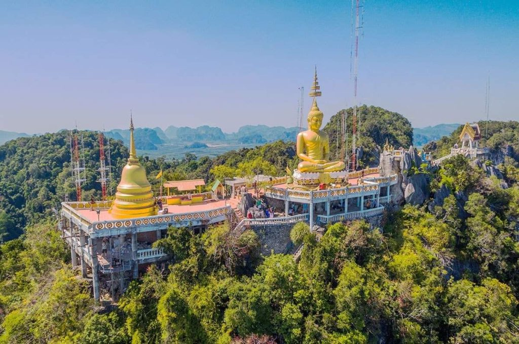aerial view of a large buddha statue on top of a cliff