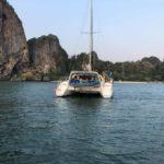 a catamaran yacht moored in a tropical island bay